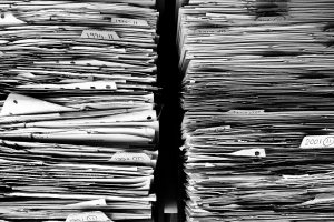 Files of paper piled up
